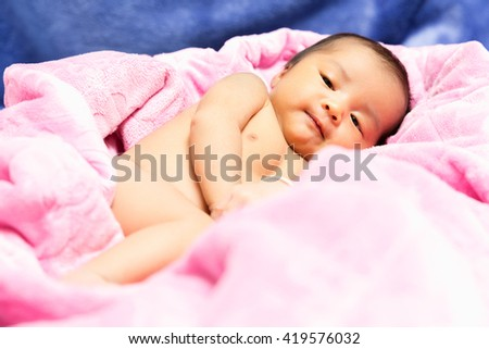 A shot of a cute newborn asian baby 14 days after birth  - stock photo