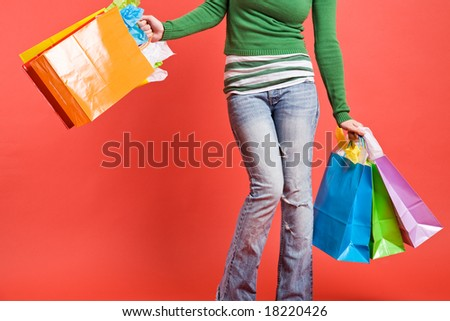 A shot of a girl carrying shopping bags - stock photo