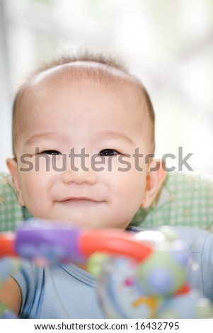 A shot of a happy asian baby boy