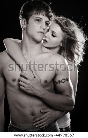 A shot of a man and a woman in love in black and white - stock photo