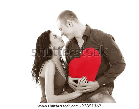 A shot of a man and a woman in love in black and white with red heart - stock photo