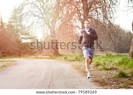 A shot of a mixed race man running outdoor - stock photo