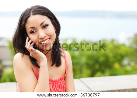 A shot of a mixed race woman talking on the phone - stock photo