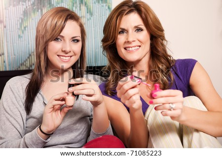 A shot of a mother spending time with her teenage daughter - stock photo