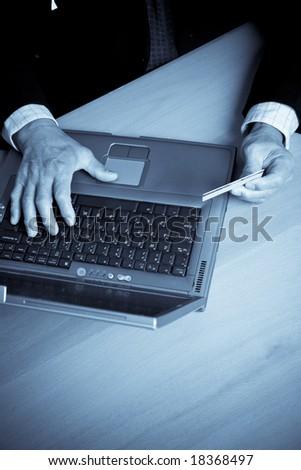 A shot of a senior businessman shopping online - stock photo