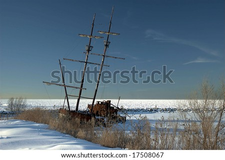 A shot of a shipwreck - frozen in time in the ice and snow