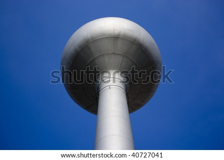 A shot of a water pressure tower made of metal and steel. Shot taken from a very low angle looking upwards. - stock photo