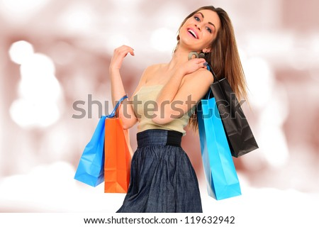 A shot of a woman with bags shopping - stock photo