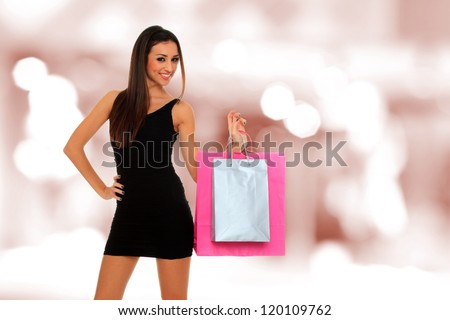 A shot of a woman with bags shopping outdoor - stock photo
