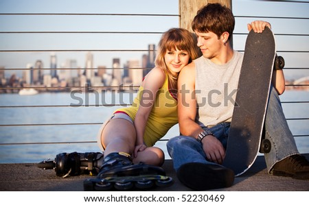 A shot of a young caucasian couple outdoor - stock photo