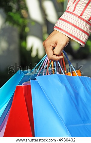A shot of a young man carrying shopping bags - stock photo