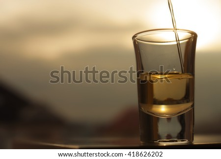 A shot of an alcohol beverage being drunk - stock photo