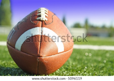 A shot of an american football on a football field
