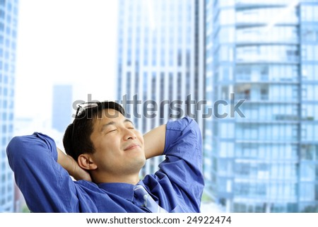 A shot of an asian businessman resting at the office - stock photo