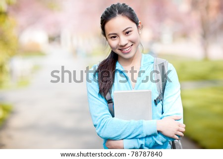 A shot of an Asian college student on campus - stock photo