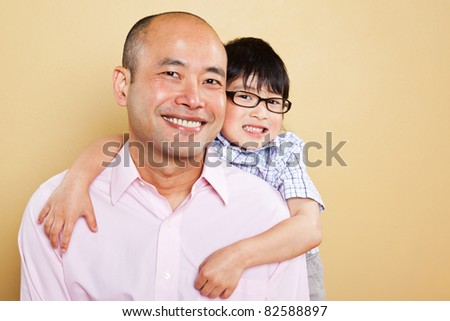 A shot of an Asian father and his cute son - stock photo