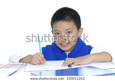 A shot of an asian kid studying at home - stock photo