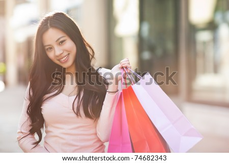 A shot of an asian woman shopping outdoor - stock photo