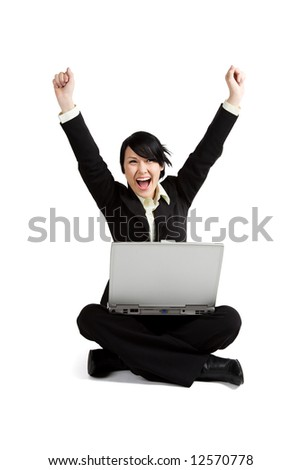 A shot of an excited businesswoman working on her laptop - stock photo