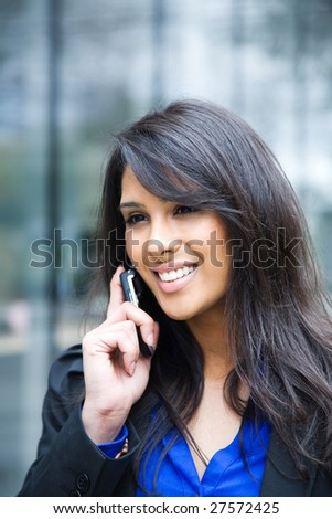 A shot of an indian businesswoman talking on the phone  outdoor - stock photo