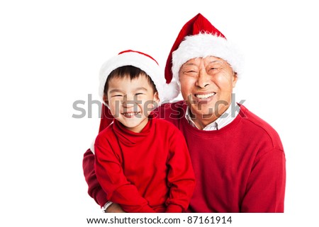 A shot of Asian grandfather celebrating Christmas with his grandson - stock photo