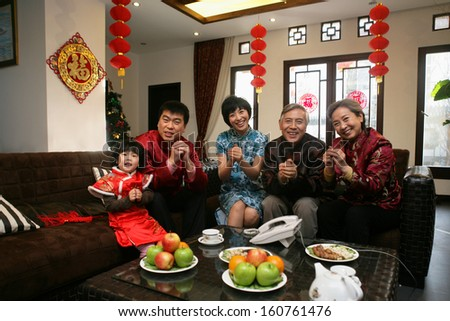 A shot of Chinese family reunion in the house  - stock photo