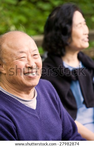 A shot of happy elderly asian couple outdoor - stock photo