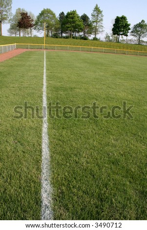 A shot of left field on a baseball diamond. - stock photo