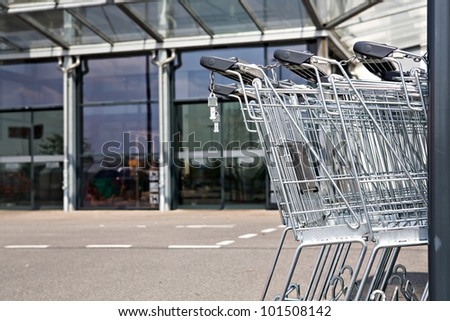 a shot of market cart and supermarket view - stock photo