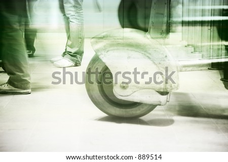 a shot of people's feet as they wait and walk through an airport - green and blue finish with subtle  stripes - stock photo