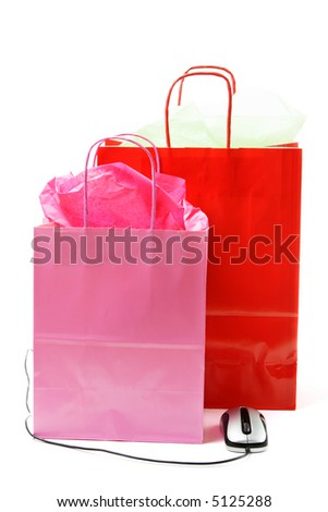 A shot of shopping bags and a mouse, can be used for ecommerce concept - stock photo
