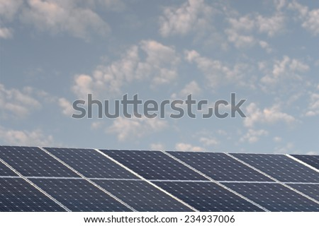 A shot of solar panels of a tiled roof - stock photo