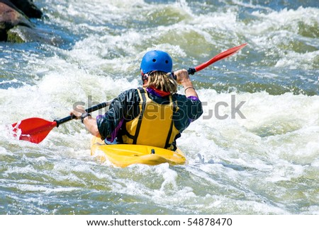 a shot of the kayaker on the rough water - stock photo
