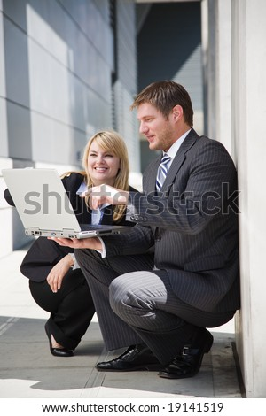 A shot of two caucasian business people working and having a discussion - stock photo