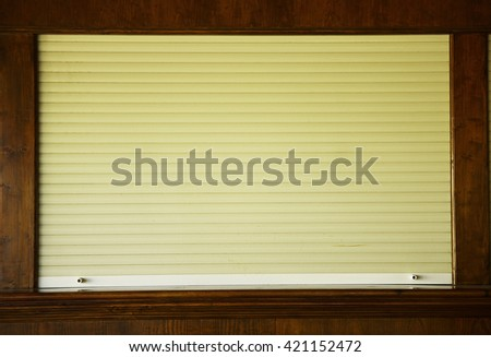 a shutters on the shop window - stock photo