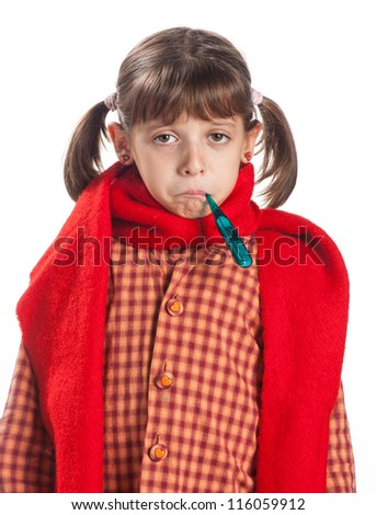 A sick child with a thermometer in her mouth - stock photo
