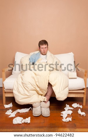A sick man on the couch