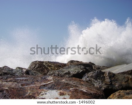 A side instant of ocean water explosion. - stock photo