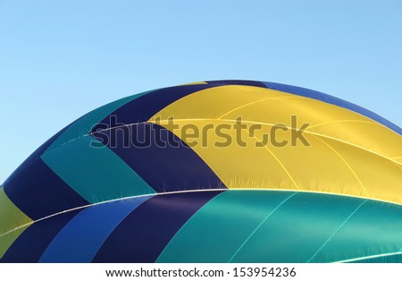 A side view of a colorful hot air balloon - stock photo