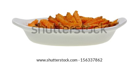 A side view of a group of frozen sweet potato french fries. - stock photo