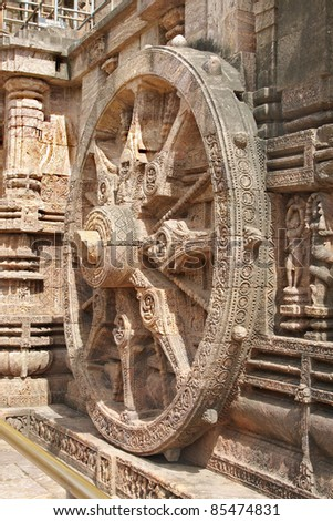 A side view of beautiful chariot Wheel, Sun temple, Konarak - stock photo
