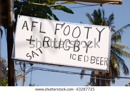 A sign advertising beer, AFL and rugby, Sanur,Bali,Indonesia - stock photo