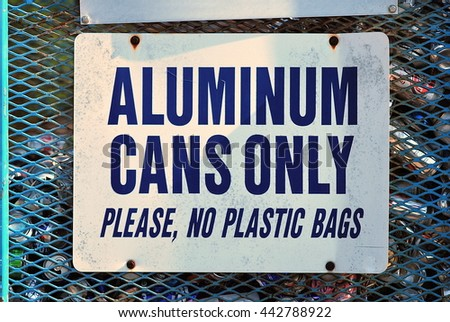 A sign at a recycling facility notifies that the bin is for 'Aluminum cans only please no plastic bags' - stock photo