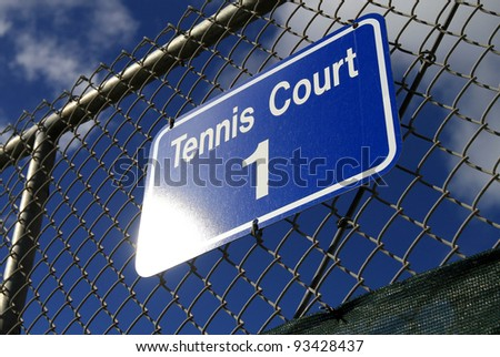 A sign displays on Tennis Court #1 - stock photo