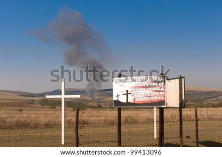 a sign explaing deaths due to crime in south africa - stock photo
