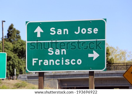 A sign in Silicon Valley showing the way to either San Jose or San Francisco. - stock photo