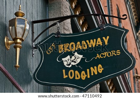 a sign indicating lodging for actors at a local theater