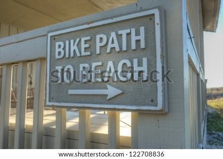 "A sign marked ""bike path to beach"" near a luxury Atlantic Ocean beach house in Hilton Head, SC."