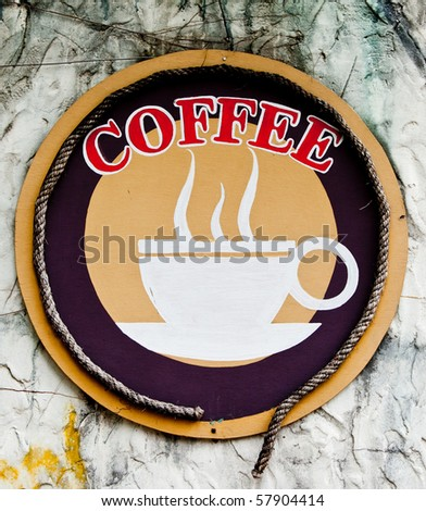 A sign of a coffee shop. - stock photo