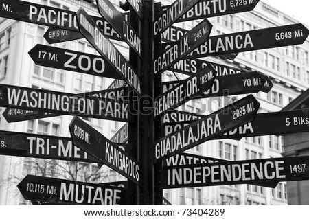 A sign of different locations in Pioneer Square, Portland, Oregon - stock photo